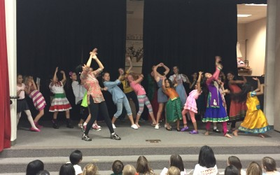 Teaching Bollywood fitness moves at Park Village Elementary School